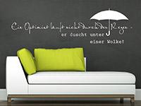 Wandtattoo Spruch Optimist in weiß im Wohnzimmer