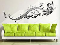 Wandtattoo Noten Schmetterling im Wohnzimmer