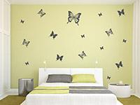 Schmetterlingsset Wandtattoo über dem Bett im Schlafzimmer
