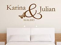 Namen Wandtattoo mit Hochzeitsdatum über dem Bett