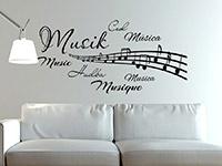Wandtattoo Wortwolke Musik in schwarz im Wohnzimmer