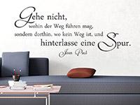 Zitat Wandtattoo Hinterlasse eine Spur als stylische Wanddeko über der Couch