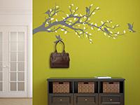Garderoben Wandtattoo Ast mit Vögeln auf grüner Wand