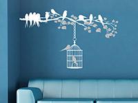 Wirkungsvoller Wandtattoo Ast mit Vogelkäfig in weiß und hellgrau