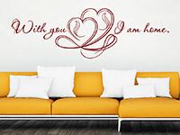 Liebesspruch Wandtattoo With you I am home über dem Sofa