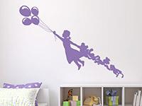 Wandtattoo Mädchen mit Luftballons im Kinderzimmer