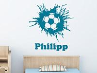 Cooles Wandtattoo Fußball mit Name auf heller Wand