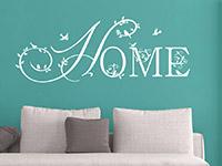 Schnörkel Wandtattoo Home über der Couch in weiß