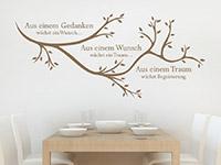 Spruch Wandtattoo Aus einem Gedanken mit Ast auf heller Wand