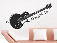 Musik Wandtattoo Plugged in im Wohnzimmer