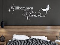Wandtattoo Willkommen im Paradies im Schlafzimmer