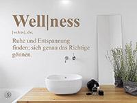 Begriff Wandtattoo Wellness auf hellem Hintergrund