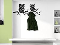 Wandtattoo Garderobe Ast mit Eulen in schwarz im Flur
