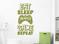 Gamer Wandtattoo Eat Sleep Game Repeat auf heller Wand